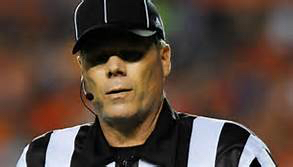 High school football officials may soon be donning headsets.