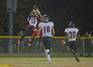 John Hardin's Justice Smith (13) and Bullitt East's Alex Elkins make a simultaneous catch on the ball.